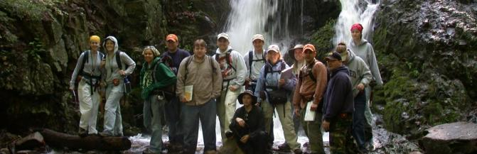 Group of students in front of a waterfall