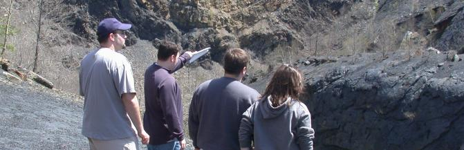 Students looking at rock formations